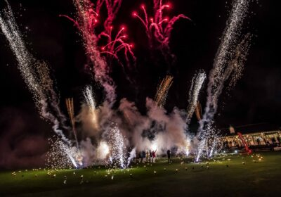 Fireworks go off in front of the cricket pavillion while Mr Wilson's Second Liners play